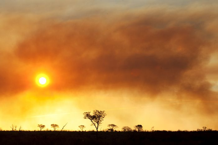 A fire in the west helps to create a dramatic sunset.